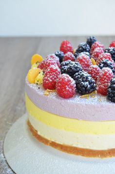 Lemon, white chocolate and black currant cheesecake with raspberries and blackberries