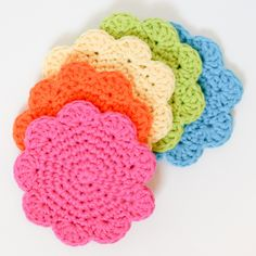 flower crochet coasters, crafts, Create an entire rainbow of coasters to bring color to your home