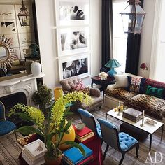 I think I pinned this already but - leopard, blue, teal, yellow, eclectic glam living room AD