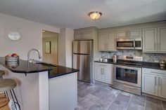 Transitional Style Kitchen By BlankSpace LLC, Pittsburgh, PA. Greige Maple  Cabinets By Ju0026K Cabinetry, Stellar Night Quartz Countertops And Moonstone  Marble ...