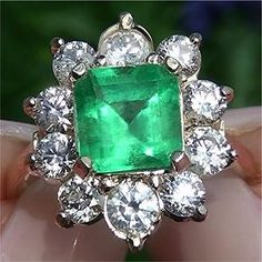 2.12ct Muzo Mined Colombian Emerald measures 7.52mm x 7.90mm. 10 VS2-SI2 G-H diamonds total 2.55ct. Ring measures 18.22mm x 16.09mm at the head and sits up 8.09mm off the finger. (certified-jewelry on eBay.com)