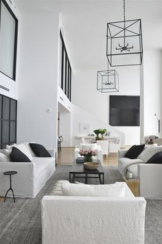 white contemporary living room with fabulous metal lights - Biscayne Blvd. Penthouse by Briggs Edward Solomon
