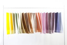 Raw Textiles by RAW COLOR is a series of hand dyed silk scarves that derived from vegetable pigments.