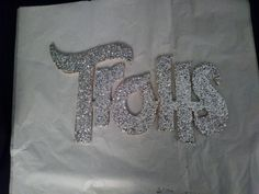 Troll sign with glitter.