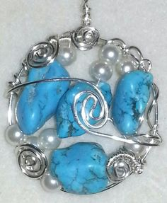 Dyed magnesite stones and glass pearls on a nontarnish silver wire :)