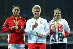 (L-R) Silver medalist Wenxiu Zhang of China, gold medalist Anita Wlodarczyk of Poland and bronze medalist Sophie Hitchon of Great Britain pose on the podium during the medal ceremony for the Women's Hammer Throw on Day 10 of the Rio 2016 Olympic Games at the Olympic Stadium on August 15, 2016 in Rio de Janeiro, Brazil.