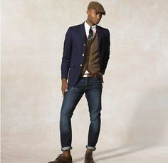 A navy blazer and navy blue jeans are a great outfit formula to have in your arsenal. Add brown leather derby shoes to your look for an instant style upgrade.   Shop this look on Lookastic: https://lookastic.com/men/looks/blazer-cardigan-dress-shirt-jeans-derby-shoes-tie-belt/221   — Navy Blazer  — White Dress Shirt  — Green Horizontal Striped Tie  — Brown Cardigan  — Navy Jeans  — Brown Leather Belt  — Brown Leather Derby Shoes
