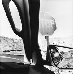 Death Valley, America by Car … 2008 … by Lee Friedlander …The frame of the car window provides a constant in the photographs of vastly different American landscapes. Here, we can also see a reflection of someone in the car, looking out…