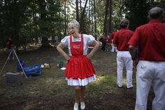 Susie Woolard jokes around with other members of the Kountry Kickers before the start of their clogging performance during the Newport News Fall Festival of Folklife on Saturday.