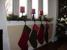 garland on bay window with shutters christmas winter pinterest window