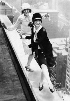 Flappers dancing on the rooftop above the city, 1920s