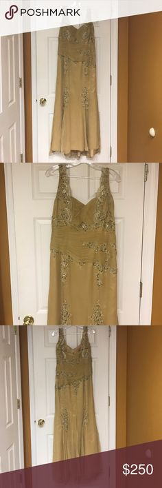 Gold silk gown with lace embroidery and sequins Gold 100% silk gown with lace embroidery, sequins, and rouching allowing for a slimmer look. Perfect for mother of the bride, groom or any formal affair. Designer jean de lys. Worn once. Size 14, slight sweep for train, see pictures train is dirty due to walking around and dragging on ground, needs to be cleaned or cut. Dresses