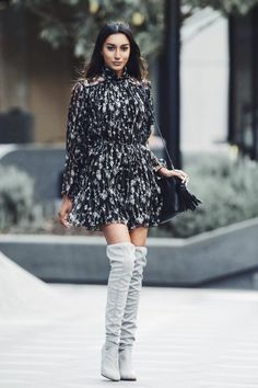 Vydia Rishie is looking super feminine in this floral playsuit, worn with over the knee boots and a little leather handbag. This outfit is perfect for those warm summer days and nights! Playsuit: Zimmerman, Boots: Tony Bianco, Bag: Gucci.