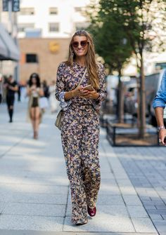 Sure, florals might be commonly associated with spring, but by wearing them in an unexpected way—like in the form of a full-length jumpsuit—the look is anything but basic.