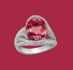 Like a riot of pinkish orange colour, the oval-shaped Padparadscha sapphire weighing 7.83 carats set within a diamond twist ring. From the 2012 Red Carpet collection.