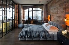 Cerramiento acristalado en dormitorio industrial | Pensata