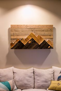 Wood Wall Art - Wooden Mountain Range Art  Made to Order or customize this look: This artwork is made up of upcycled wood scraps. Wood was trimmed to size and stained with traditional and hand made stains. The piece features two mountain ranges that stand out from each other based on their color and both mountain ranges also come backlit with micro LEDs. Roughly 25X43  I currently only have one in stock and am working on two more pieces that will be done for Christmas. The next pieces will…