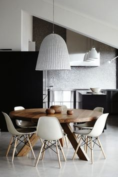rattan light over table with eames
