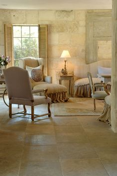 Chateau Domingue Timeless European Elegance and French farmhouse style converge in this house tour of founder Ruth Gay's home on Hello Lovely. Reclaimed stone antique doors and mantels and one of a kind architectural elements. - June 30 2019 at French Farmhouse Decor, French Country Living Room, French Country Cottage, Farmhouse Interior, French Country Style, French Decor, French Country Decorating, Farmhouse Design, Cottage Chic