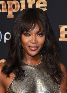 Naomi Campbell Long Wavy Cut with Bangs - Naomi Campbell looked as fab as ever wearing this youthful wavy 'do with wispy bangs at the 'Empire' season 2 premiere in New York. Great Haircuts, Popular Haircuts, Naomi Campbell, Heart Shaped Face Hairstyles, Medium Length Cuts, Celebrity Wigs, Loose Ponytail, Wigs For Sale, Long Faces