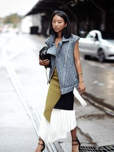 The vest is sleek and the skirt so mod, it makes a fabulous combination on this Asian beauty.
