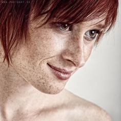 Portrait of red haired freckled girl with distinctive face
