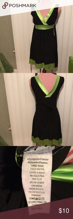 Super cute black and satin lime green dress! Super cute black dress trim in lime green satin, the dress is the stretchy material... it's just before the knees..perfect fit! Also you can tie it in the back shown in the second picture! Taboo Dresses