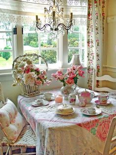 in love. curtains, flowers, tea set.