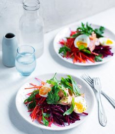 This is the perfectly light summer salad - shredded beetroot and carrot work wonders with smoke trout, while a horseradish dressing adds a tangy touch.