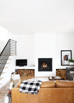SMOOTH: We love all the smooth fireplaces we're seeing lately! It's no fuss, clean and makes a simple, but big statement. Keep it monochromatic or pair it with a natural element like raw wood or concrete.