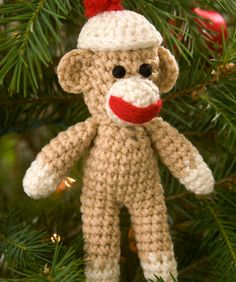 "Sock Monkey Ornament Crochet Pattern @Red Heart: Download Printable Instructions. Sock Monkey measures 7"" high. Designed By: Linda Cyr. Skill Level: Easy."