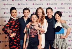 How I see this picture = Henry Mills with (L to R) his mom the former evil queen, his great grand father Peter Pan, his aunt the wicked witch of the west, his family friend Robin Hood and his step grandmother belle.