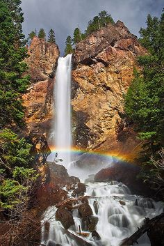 A rainbow forms in the mist created by the thundering Treasure Falls in the San Juan Mountains of southwest Colorado.