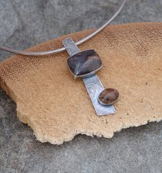 STERLING SILVER PENDANT WITH BEZEL SET  RED CALCITE STONES (RED CALCITE HAS A BLACK-BROWN VEIN) ROLLING MILL TEXTURED
