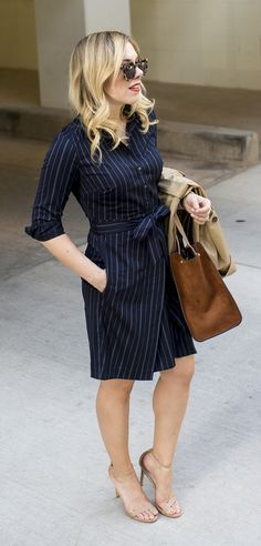 Keep your look polished with our menswear-inspired Pinstripe Tie-Waist Shirtdress. Pair this navy dress with a strappy, sleek heel like @allywonderland to keep it chic. Shop now | Banana Republic