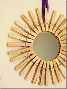 Clothespin Starburst Mirror from the Dollar Store.  This is really cute.  I'm wondering if I can attach the clothespins the opposite way so it would hold Christmas card photos?
