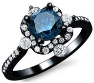 Black ring with a blue Sapphire gem surrounded by diamonds.