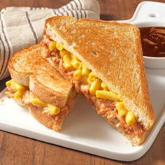 Memphis-Style Mac and Cheese Sandwiches- A grilled 'cheese' sandwich recipe goes Memphis-style when chicken with a little BBQ sauce is layered under mac and cheese.