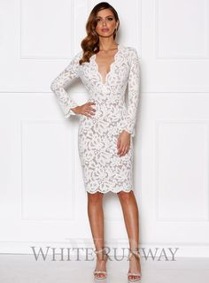 8a490b24d349 A stunning midi length dress by Grace   Hart. A long sleeve lace dress  featuring a deep v-neckline and scalloped edging on the neckline and  hemline.