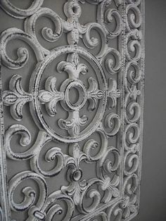 Salvage Dior: Rubber Door Mat Wall Art. Thinking of making one into a faux fence 'gate grate', as wrought iron ones are too $$.