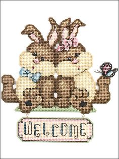 Bunnies Welcome Plastic Canvas Pattern Download from e-PatternsCentral.com -- These spring bunnies are sure to bring a springtime welcome.