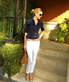 White ankle jeans, brown leather belt, and simple navy blouse