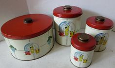 Darling Set of 4 Vintage Kitchen Cannisters. Bright vibrant colors. The three fit one inside the other. The larger round one is separate from the set but matches the others. Great size for storing cookies, etc. Measurements are: Large Round 8 3/4 inches across and 5 inches tall. The others are 6 1/2 inches tall, 5 1/4 inches tall, and 4 inches tall. Good vintage condition. The large cannister has some white dots as shown in the last photo. I made no attempt to remove them but you may be able…