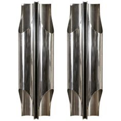 Maison CHARLES - Pair of Stainless Steel Wall Sconces | From a unique collection of antique and modern wall lights and sconces at http://www.1stdibs.com/lighting/sconces-wall-lights/