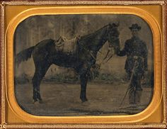 Historic Horse Photography; The American Civil War: Unidentified soldier in Union uniform with cavalry saber standing next to horse fitted with McClellan saddle, taken between 1861 and 1865, Library of Congress
