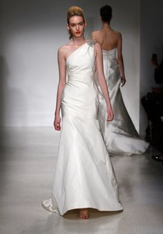 Gown features beaded floral detail and asymmetric bow.