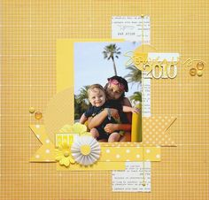 Simple layout by MC Scrap.   Love the floss attached by brads down the page.