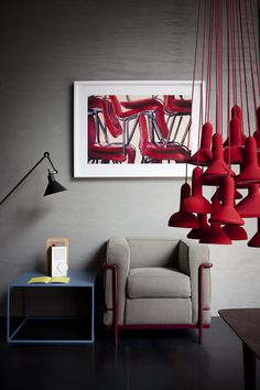 Studiopepe Spotti. This is a superb combination between grey walls and red lights. What do you think?