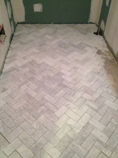 Carrara subway tile installed in herringbone pattern. I need this in my future bathroom. GORGEOUS!!!