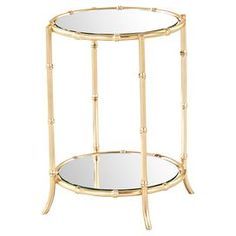 """Perfect for displaying a bouquet of fresh blooms or cherished family photos, this eye-catching side table showcases a beautiful mirrored glass top and gold leaf finish   Product: Side tableConstruction Material: Iron and mirrored glassColor: Gold leafFeatures:  Bamboo motif HandmadeNo assembly requiredDimensions: 21"""" H x 17.5"""" DiameterCleaning and Care: Wipe clean with damp cloth. Mild dishsoap when needed."""
